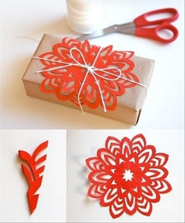 red paper snowflake - do it yourself Christmas packagedecoration or ornament