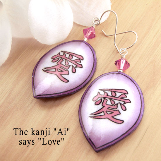 Japanese kanji pink and purple paper earrings that say Love
